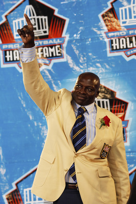 CANTON, OH - AUGUST 8: Bruce Smith acknowledges Buffalo Bills fans during the 2009 Pro Football Hall of Fame Enshrinement Ceremony at Fawcett Stadium on August 8, 2009 in Canton, Ohio. (Photo by Joe Robbins/Getty Images)