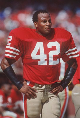 23 Sep 1990:  Strong safety Ronnie Lott of the San Francisco 49ers stands and relaxes on the sideline while the offense is on the field during the 49ers 19-13 victory over the Atlanta Falcons at Candlestick Park in San Francisco, California.   MandatoryCr
