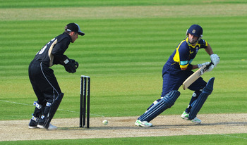 SOUTHAMPTON, ENGLAND - APRIL 24:  Neil McKenzie of Hamphire strikes a boundary as wicketkeeper Richard Johnson of Warwickshire looks on during the Clydesdale Bank 40 match between Hampshire and Warwickshire at The Rose Bowl on April 24, 2011 in Southampto