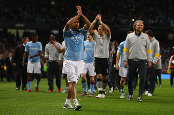 MANCHESTER, ENGLAND - MAY 17:  Carlos Tevez of Manchester City waves to the crowd on a lap of honour after the Barclays Premier League match between Manchester City and Stoke City at City of Manchester Stadium on May 17, 2011 in Manchester, England.  (Pho