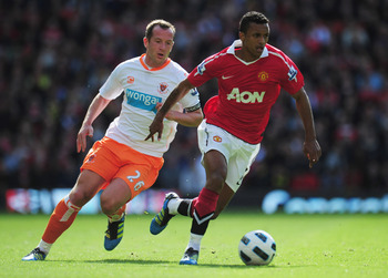 MANCHESTER, ENGLAND - MAY 22:  Luis Nani of Manchester United evades Charlie Adam of Blackpool during the Barclays Premier League match between Manchester United and Blackpool at Old Trafford on May 22, 2011 in Manchester, England.  (Photo by Shaun Botter