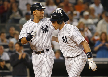 NEW YORK - MAY 21:  Mark Teixeira #25 of the New York Yankees is congradulated by teammate Derek Jeter #2 after hitting a two run homerun in the bottom of the third inning against the New York Mets on May 21, 2011 at Yankee Stadium in the Bronx borough of