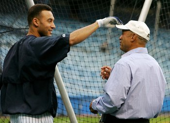 NEW YORK - SEPTEMBER 13:  Derek Jeter #2 (L) of the New York Yankees jokes with Yankee legend and Hall of Famer Reggie Jackson before playing the Tampa Bay Devil Rays on September 13, 2006 at Yankee Stadium in the Bronx borough of New York City.  (Photo b