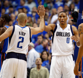 DALLAS, TX - MAY 17:  (C) Shawn Marion #0 of the Dallas Mavericks reacts with teammate Jason Kidd #2 in the third quarter while taking on the Oklahoma City Thunder in Game One of the Western Conference Finals during the 2011 NBA Playoffs at American Airli