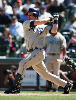 SAN FRANCISCO- JULY 22:   Mark Loretta #8 of the San Diego Padres hits a home run in the 9th inning against the San Francisco Giants July 22, 2004 at SBC Park in San Francisco, California. (Photo by Jed Jacobsohn/Getty Images)
