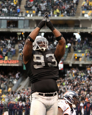 OAKLAND, CA - DECEMBER 19:  Tommy Kelly #93 of the Oakland Raiders celebrates after the Raiders scored a safety during their game against the Denver Broncos at Oakland-Alameda County Coliseum on December 19, 2010 in Oakland, California.  (Photo by Ezra Sh