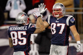 FOXBORO, MA - DECEMBER 06:  (L-R) Aaron Hernandez #85 and Rob Gronkowski #87 of the New England Patriots celebrate a play against the New York Jets at Gillette Stadium on December 6, 2010 in Foxboro, Massachusetts. The Patriots won 45-3. (Photo by Jim Rog