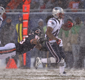 CHICAGO, IL - DECEMBER 12: BenJarvus Green-Ellis #42 of the New England Patriots breaks away from Lance Briggs #55 of the Chicago Bears at Soldier Field on December 12, 2010 in Chicago, Illinois. The Patriots defeated the Bears 36-7. (Photo by Jonathan Da