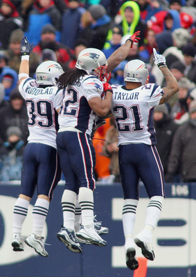 ORCHARD PARK, NY - DECEMBER 26: Danny Woodhead #39, Benjarvus Green-Ellis #42, and Fred Taylor #21  of the Patriots celebrate a touchdown in the first quarter against the Buffalo Bills at Ralph Wilson Stadium on December 26, 2010 in Orchard Park, New York