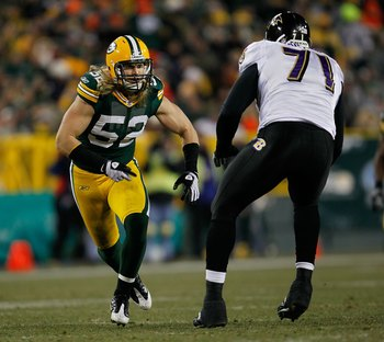 GREEN BAY, WI - DECEMBER 07: Clay Matthews #52 of the Green Bay Packers rushes against Jared Gaither #71 of the Baltimore Ravens at Lambeau Field on December 7, 2009 in Green Bay, Wisconsin. The Packers defeated the Ravens 27-17. (Photo by Jonathan Daniel