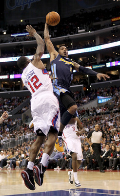 LOS ANGELES, CA - MARCH 5:   J.R. Smith #5 of the Denver Nuggets goes up for a shot against Eric Bledesoe #12 of the Los Angeles Clippers at Staples Center on March 5, 2011 in Los Angeles, California. The Clippers won 100-94. NOTE TO USER: User expressly