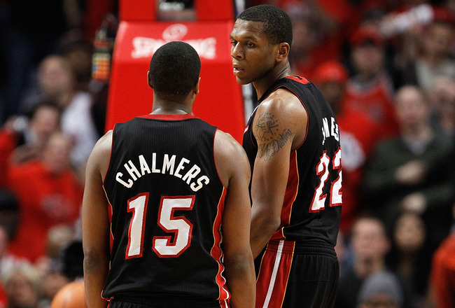 CHICAGO, IL - MAY 15: Mario Chalmers #15 and James Jones #22 of the Miami Heat talk on court against the Chicago Bulls in Game One of the Eastern Conference Finals during the 2011 NBA Playoffs on May 15, 2011 at the United Center in Chicago, Illinois. The