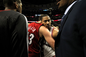 CHICAGO, IL - MAY 26:  Derrick Rose #1 of the Chicago Bulls looks on dejected as he congratulates Mike Miller #13 of the Miami Heat after the Heat won 83-80 in Game Five of the Eastern Conference Finals during the 2011 NBA Playoffs on May 26, 2011 at the