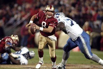 14 Dec 1998: Steve Young #8 of the San Francisco 49ers is sacked by Darrius Holland #73 of the Detroit Lions at 3Com Park in San Francisco, California. The 49ers defeated the Lions 35-13. Mandatory Credit: Jed Jacobsohn  /Allsport