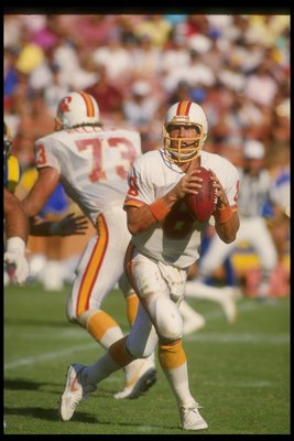 5 Oct 1986:  Quarterback Steve Young of the Tampa Bay Buccaneers looks to pass the ball during a game against the Los Angeles Rams at Anaheim Stadium in Anaheim, California.  The Rams won the game, 26-20. Mandatory Credit: Rick Stewart  /Allsport