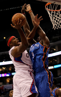 LOS ANGELES, CA - NOVEMBER 03:  Craig Smith #1 of the Los Angeles Clippers shoots over Serge Ibaka #9 of the Oklahoma City Thunder at Staples Center on November 3, 2010 in Los Angeles, California. The Clippers won 107-92.  NOTE TO USER: User expressly ack