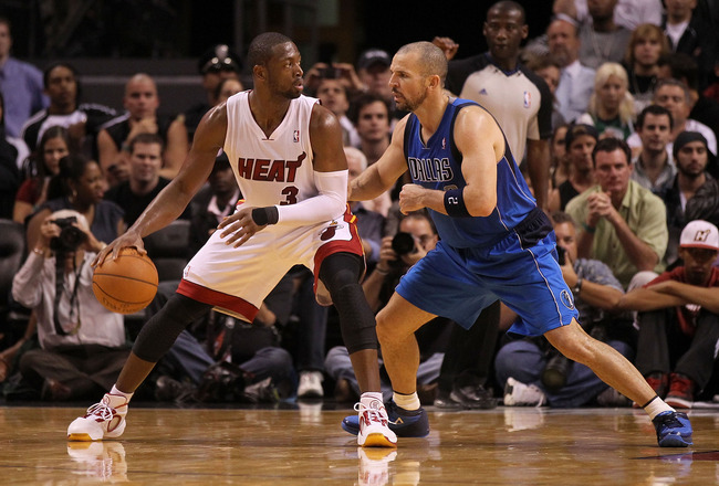 MIAMI, FL - DECEMBER 20:  Dwyane Wade #3 of the Miami Heat posts up Jason Kidd #2 of the Dallas Mavericks during a game at American Airlines Arena on December 20, 2010 in Miami, Florida. NOTE TO USER: User expressly acknowledges and agrees that, by downlo