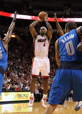 MIAMI, FL - DECEMBER 20: LeBron James #6 of the Miami Heat shoots a jump shotduring a game against the Dallas Mavericks at American Airlines Arena on December 20, 2010 in Miami, Florida. NOTE TO USER: User expressly acknowledges and agrees that, by downlo