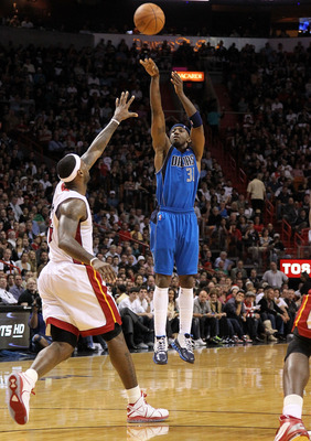 MIAMI, FL - DECEMBER 20:  Jason Terry #31 of the Dallas Mavericks shoots over LeBron James #6 of the Miami Heat during a game at American Airlines Arena on December 20, 2010 in Miami, Florida. NOTE TO USER: User expressly acknowledges and agrees that, by