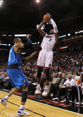 MIAMI, FL - DECEMBER 20: Dwyane Wade #3 of the Miami Heat shoots over Shawn Marion #0 of the Dallas Mavericks during a game at American Airlines Arena on December 20, 2010 in Miami, Florida. NOTE TO USER: User expressly acknowledges and agrees that, by do