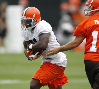 BEREA, OH - MAY 01:  Montario Hardesty #31 of the Cleveland Browns takes a hand off from Colt McCoy #12 during rookie mini camp at the Cleveland Browns Training and Administrative Complex on May 1, 2010 in Berea, Ohio.  (Photo by Gregory Shamus/Getty Imag
