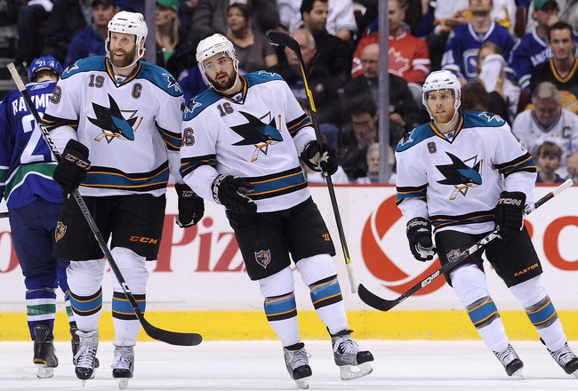 VANCOUVER, CANADA - MAY 24:  (L-R) Joe Thornton #19, Devin Setoguchi #16 and Joe Pavelski #8 of the San Jose Sharks look to celebrate the goal by teammate Patrick Marleau #12 (not in photo)  in Game Five of the Western Conference Finals against the Vancou