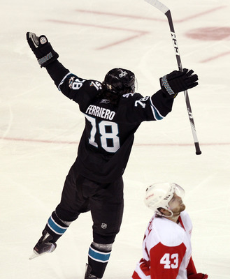 SAN JOSE, CA - APRIL 29:  Benn Ferriero #78 of the San Jose Sharks celebrates in front of Darren Helm #43 of the Detroit Red Wings after he made the winning goal in overtime of Game One of the Western Conference Semifinals during the 2011 NHL Stanley Cup