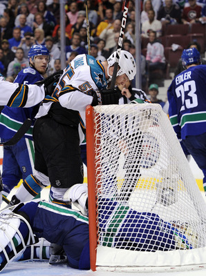 VANCOUVER, BC - MAY 18:  Ben Eager #55 of the San Jose Sharks stands over and taunts goaltender Roberto Luongo #1 of the Vancouver Canucks after scoring a goal late in the third period in Game Two of the Western Conference Finals during the 2011 Stanley C