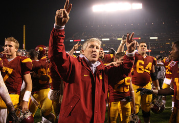 SAN FRANCISCO - DECEMBER 26: Head coach Pete Carroll of the USC Trojans celebrates after defeating the Boston College Eagles during the 2009 Emerald Bowl at AT&T Park on December 26, 2009 in San Francisco, California. (Photo by Jed Jacobsohn/Getty Images)