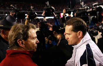TUSCALOOSA, AL - NOVEMBER 26:  Head coach Gene Chizik of the Auburn Tigers is congratulated by head coach Nick Saban of the Alabama Crimson Tide after the Tigers 28-27 win at Bryant-Denny Stadium on November 26, 2010 in Tuscaloosa, Alabama.  (Photo by Kev