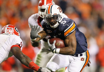 AUBURN, AL - NOVEMBER 13:  Michael Dyer #5 of the Auburn Tigers rushes towards Alec Ogletree #9 of the Georgia Bulldogs at Jordan-Hare Stadium on November 13, 2010 in Auburn, Alabama.  (Photo by Kevin C. Cox/Getty Images)