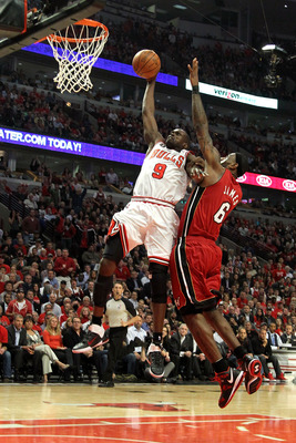 CHICAGO, IL - MAY 26:  Luol Deng #9 of the Chicago Bulls dunks against LeBron James #6 of the Miami Heat in Game Five of the Eastern Conference Finals during the 2011 NBA Playoffs on May 26, 2011 at the United Center in Chicago, Illinois. NOTE TO USER: Us