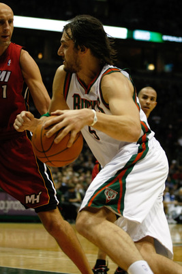 MILWAUKEE, WI - JANUARY 07: Andrew Bogut #6 of the Milwaukee Bucks drives to the basket against the Miami Heat at the Bradley Center on January 7, 2011 in Milwaukee, Wisconsin. NOTE TO USER: User expressly acknowledges and agrees that, by downloading and