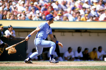 OAKLAND, CA - 1989:  George Brett #5 of the Kansas City Royals watches the flight of the ball as he follows through on his swings during a game against the Oakland Athletics at Oakland-Alameda County Coliseum in 1989 in Oakland, California.  (Photo by Ott