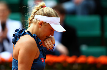 PARIS, FRANCE - MAY 27:  Caroline Wozniacki of Denmark shows her dejection during the women's singles round three match between Caroline Wozniacki of Denmark and Daniela Hantuchova of Slovakia on day six of the French Open at Roland Garros on May 27, 2011