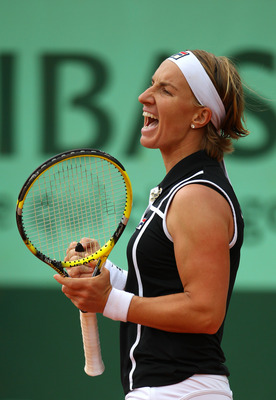 PARIS, FRANCE - MAY 27:  Svetlana Kuznetsova of Russia celebrates matchpoint during the women's singles round three match between Rebecca Marino of Canada and Svetlana Kuznetsova of Russia on day six of the French Open at Roland Garros on May 27, 2011 in