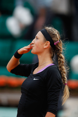 PARIS, FRANCE - MAY 26:  Victoria Azarenka of Belarus blows a kiss to the crowd as she celebrates match point during the women's singles round two match between Pauline Parmentier of France and Victoria Azarenka of Belarus on day five of the French Open a