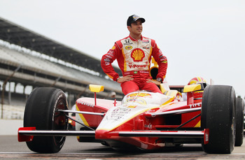 INDIANAPOLIS, IN - MAY 21:  Helio Castroneves of Brazil, driver of the Shell V-Power/Penzoil Ultra Team Penske Dallara Honda, poses for an official portrait during qualifying for the Indianapolis 500 on May 21, 2011 at Indianapolis Motor Speedway in India