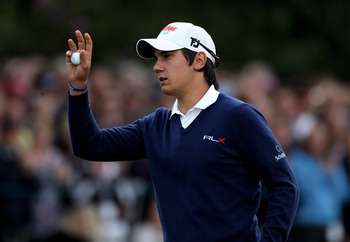 VIRGINIA WATER, ENGLAND - MAY 27:  Matteo Manassero of Italy acknowledges the crowd on the 18th green during the second round of the BMW PGA Championship at the Wentworth Club on May 27, 2011 in Virginia Water, England.  (Photo by Warren Little/Getty Imag