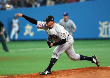 OSAKA, JAPAN-NOVEMBER 10: Pitcher Roger Clemens #22 of the Houston Astros pitches during the 5th game of the exhibition series between US MLB and Japanese professional baseball at Osaka Dome on November 10, 2004 in Osaka , Japan. (Photo by Koichi Kamoshid