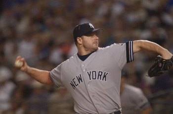 4 Nov 2001:  Roger Clemens #22 of the New York Yankees climbs up the mound during game seven of the Major League Baseball World Series at Bank One Ballpark in Phoenix, Arizona. The Diamondbacks won 3-2 to capture the World Series title. DIGITAL IMAGE. Man