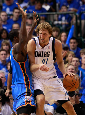 DALLAS, TX - MAY 17:  Dirk Nowitzki #41 of the Dallas Mavericks backs down Serge Ibaka #9 of the Oklahoma City Thunder in Game One of the Western Conference Finals during the 2011 NBA Playoffs at American Airlines Center on May 17, 2011 in Dallas, Texas.