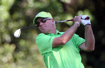 PALM HARBOR, FL - MARCH 17:  John Daly plays a shot on the 9th hole during the first round of the Transitions Championship at Innisbrook Resort and Golf Club on March 17, 2011 in Palm Harbor, Florida.  (Photo by Sam Greenwood/Getty Images)