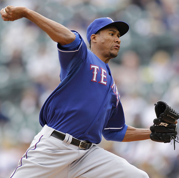 DETROIT, MI - APRIL 11:  Alexi Ogando #41 of the Texas Rangers throws a pitch while playing the Detroit Tigers at Comerica Park on April 11, 2011 in Detroit, Michigan.  (Photo by Gregory Shamus/Getty Images)