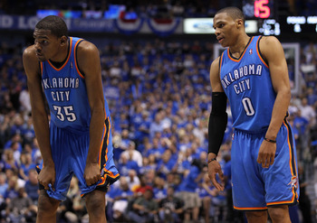 DALLAS, TX - MAY 25:  Kevin Durant #35 and Russell Westbrook #0 of the Oklahoma City Thunder stand next to each other on the court in the fourth quarter while taking on the Dallas Mavericks in Game Five of the Western Conference Finals during the 2011 NBA