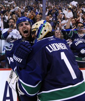 VANCOUVER, CANADA - MAY 24:  Alex Burrows #14 and goaltender Roberto Luongo #1 of the Vancouver Canucks celebrate after defeating the San Jose Sharks 3-2 in double-overtime in Game Five to win the Western Conference Finals during the 2011 Stanley Cup Play