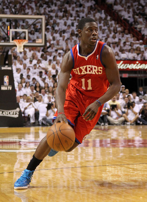 MIAMI, FL - APRIL 18:  Jrue Holiday #11 of the Philadelphia 76ers dribbles   during game two of the Eastern Conference Quarterfinals against the Miami Heat  at American Airlines Arena on April 18, 2011 in Miami, Florida. NOTE TO USER: User expressly ackno