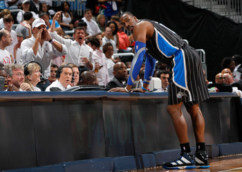 ATLANTA, GA - APRIL 28:  Dwight Howard #12 of the Orlando Magic stands at the scorer's table after being earning a technical foul against Zaza Pachulia #27 of the Atlanta Hawks during Game Six of the Eastern Conference Quarterfinals in the 2011 NBA Playof