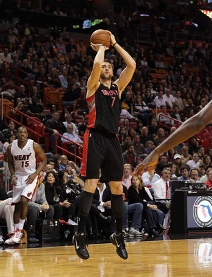 MIAMI, FL - JANUARY 22: Andrea Bargnani #7 of the Toronto Raptors shoots a jump shot during a game against the Miami Heat at American Airlines Arena on January 22, 2011 in Miami, Florida. NOTE TO USER: User expressly acknowledges and agrees that, by downl
