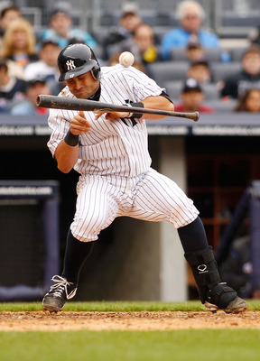 NEW YORK - MAY 22:  Francisco Cervelli #17 of the New York Yankees is hit by the pitch as he attempts to bunt in the seventh inning during the game against the New York Mets on May 22, 2011 at Yankee Stadium in the Bronx borough of New York City.  (Photo